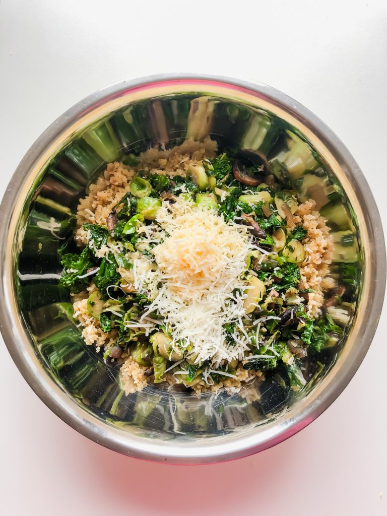 quinoa, vegetables, and cheese in a bowl
