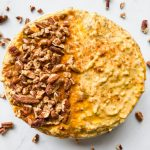 Pumpkin Pie Protein Overnight Oats in a bowl with pecans