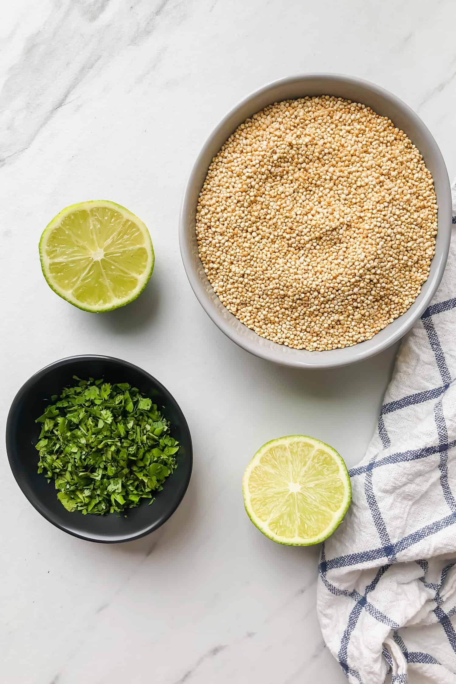 ingredients for cilantro lime quinoa in bowls: cilantro, limes, quinoa