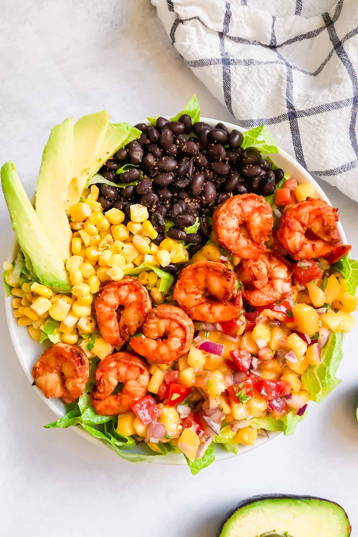 shrimp taco salad bowl with blue tablecloth