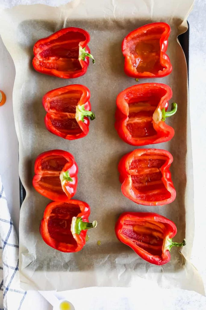 bell peppers cut in half on a sheet pan