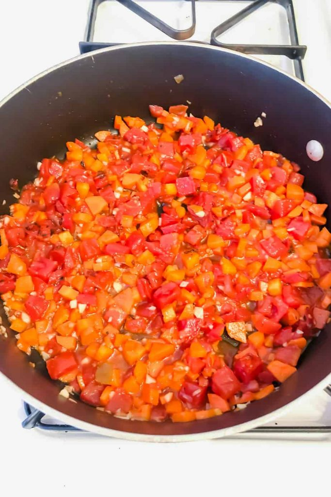 carrots, garlic, diced tomatoes in a pan