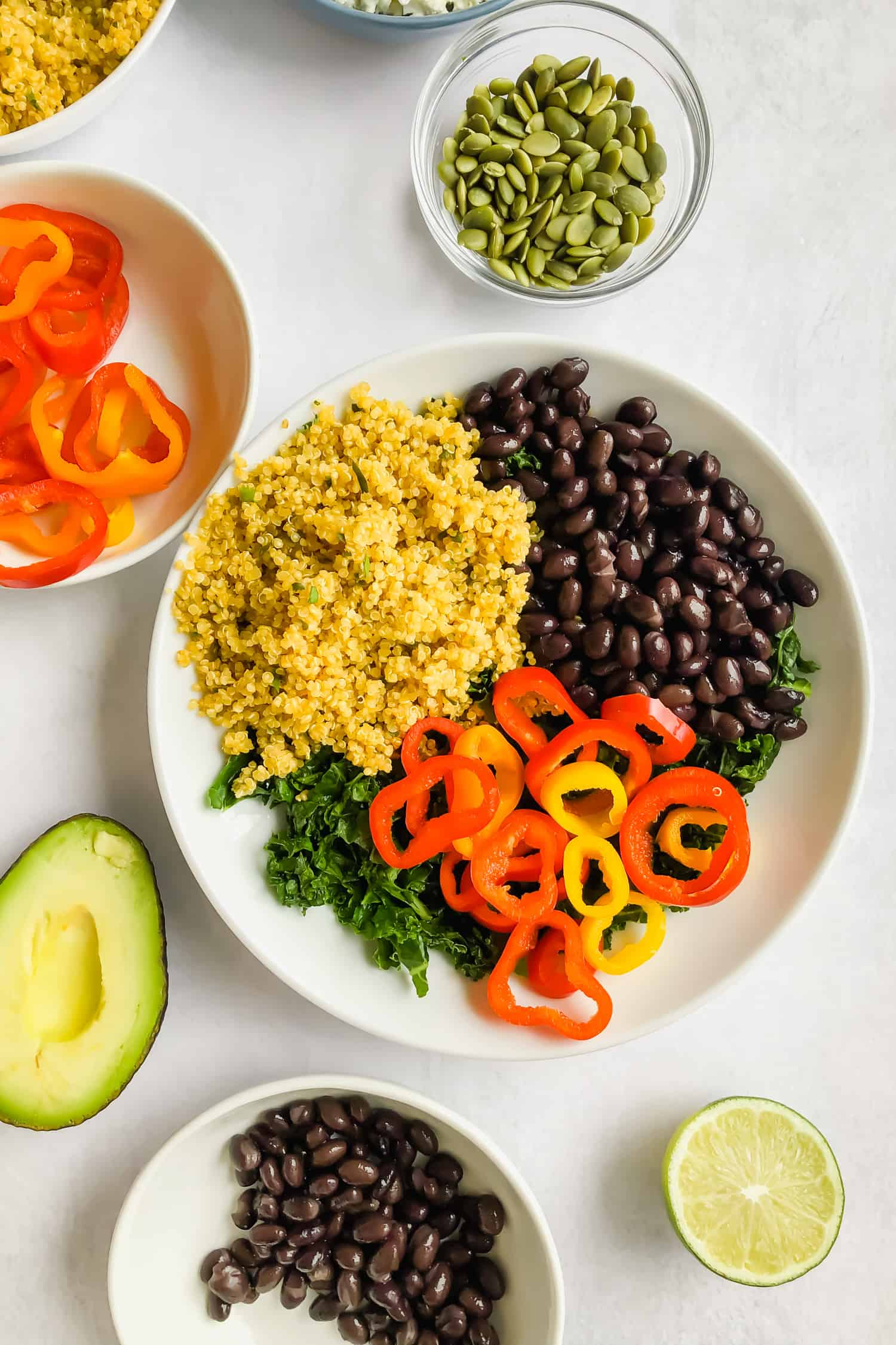 kale, black beans, quinoa, and peppers in bowl