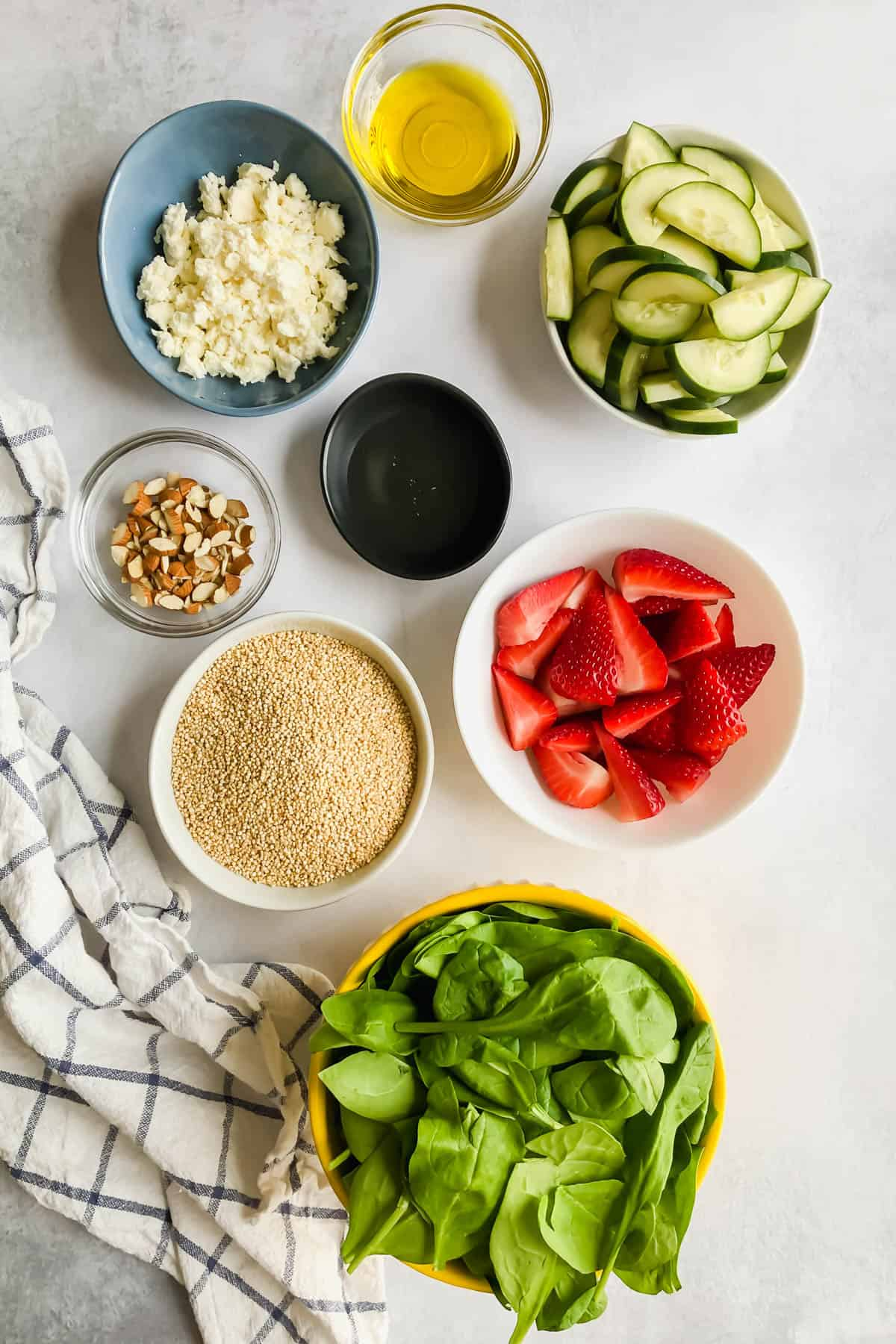 ingredients for Cucumber Strawberry Salad in bowls