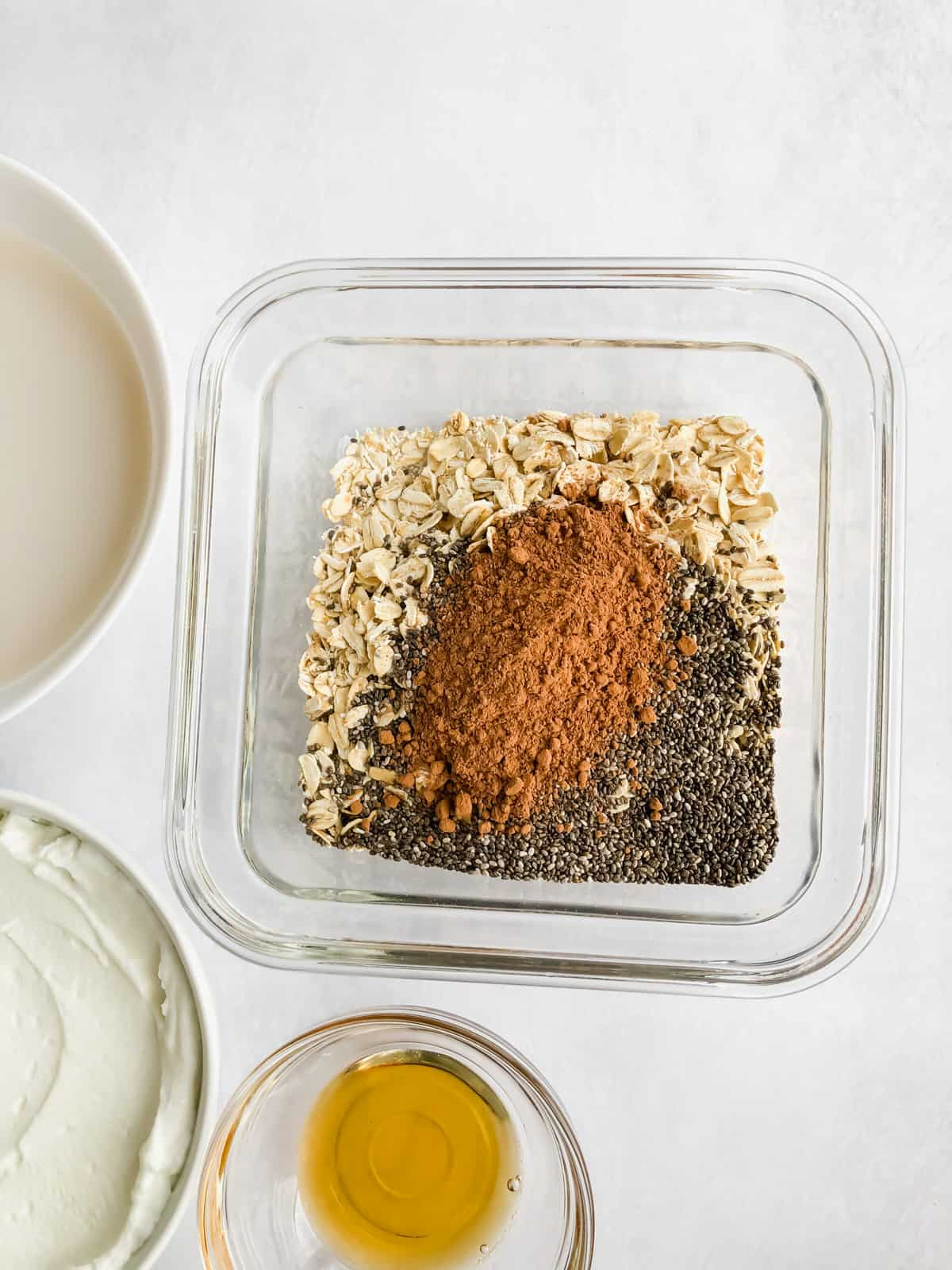 oats, cocoa, chia seeds in a food storage container