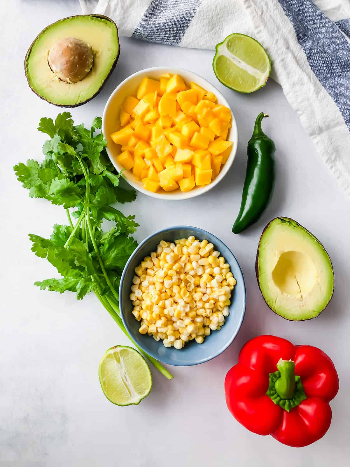 ingredients for mango corn salsa in bowls