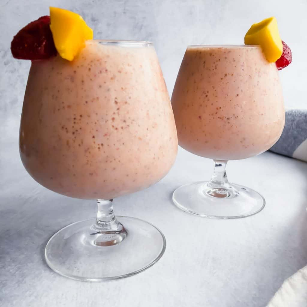 Banana Mango Strawberry Smoothie in two glasses