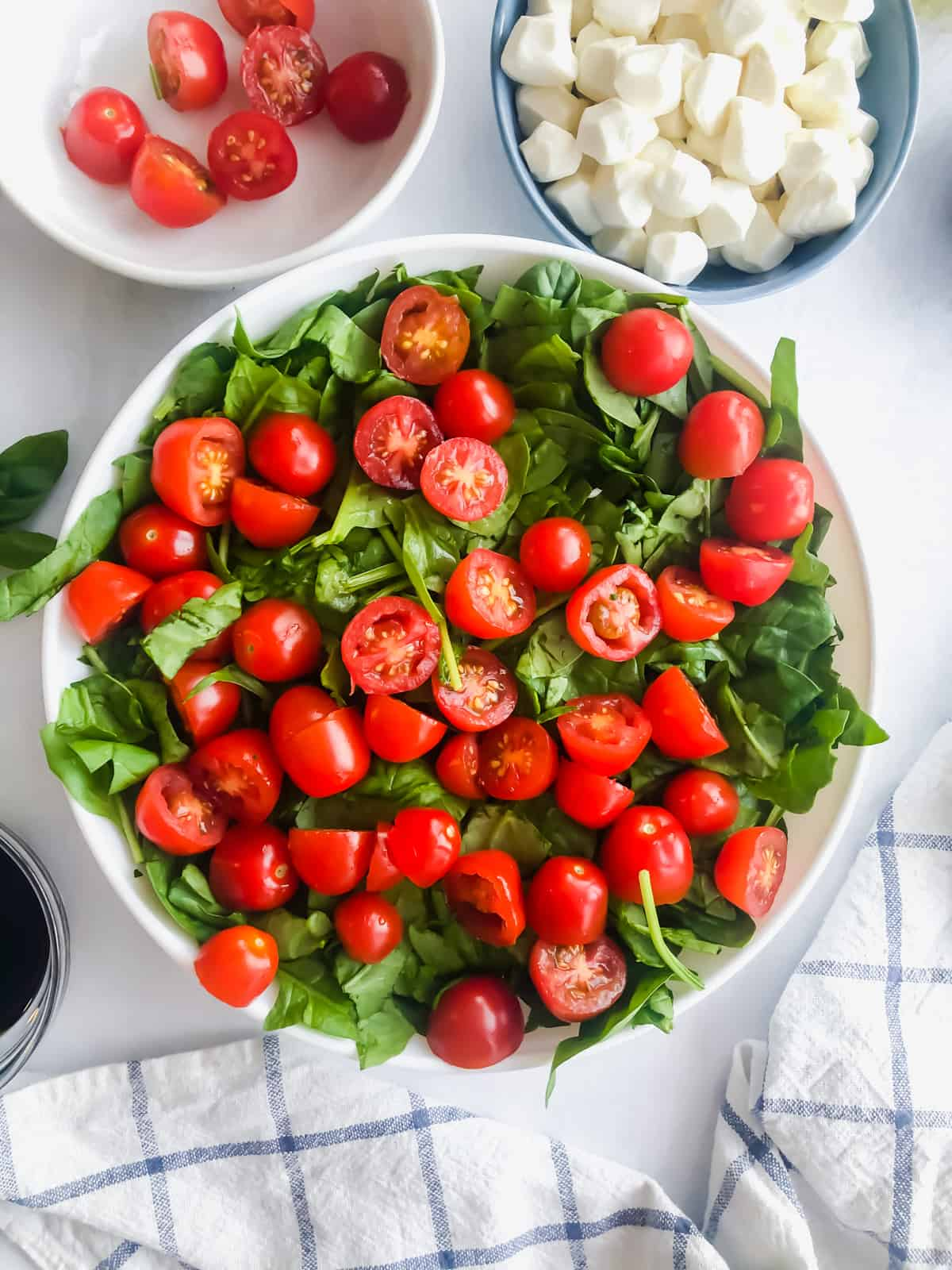 spinach and tomatoes in a bowl