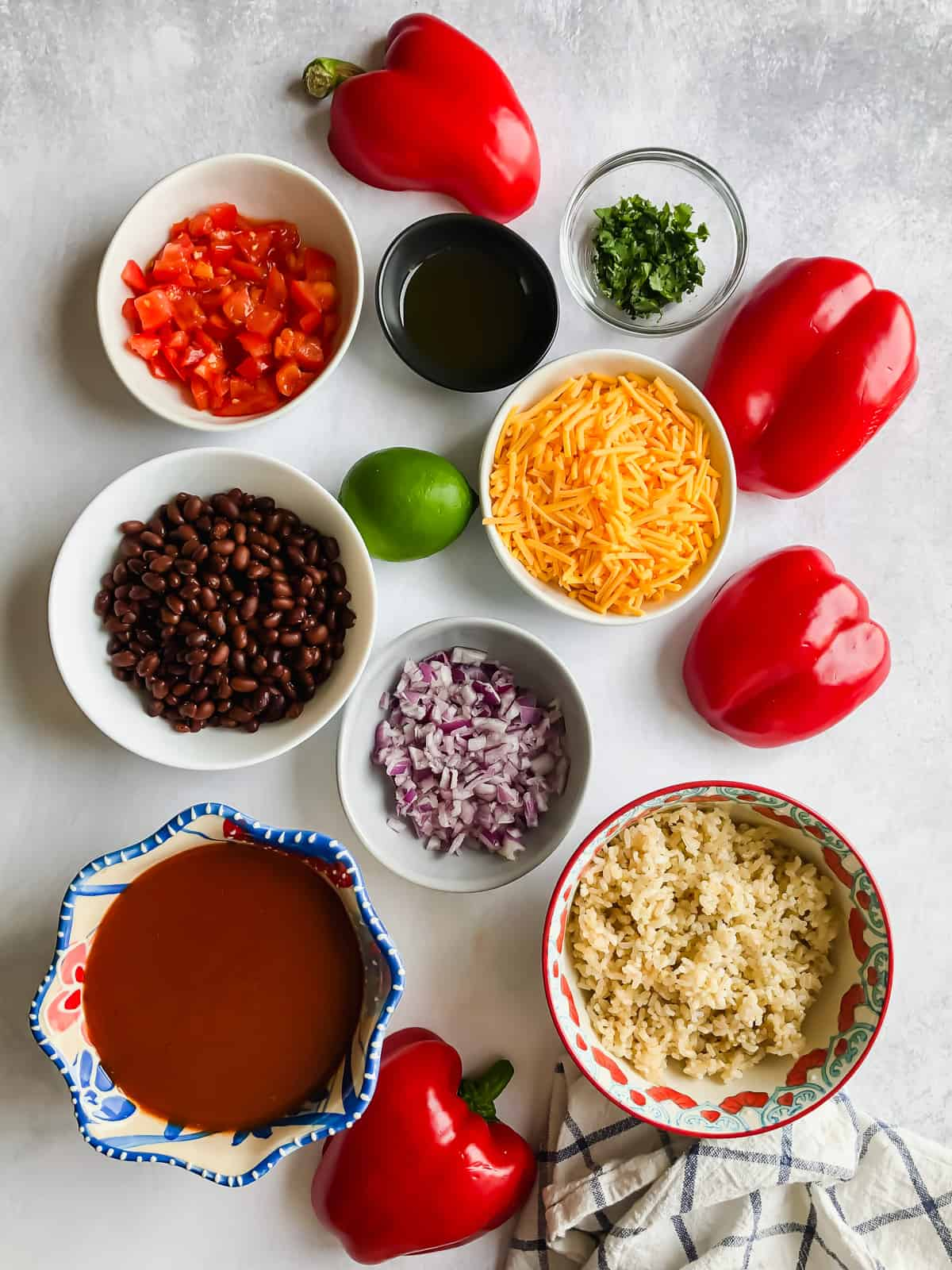 Ingredients for Enchilada Stuffed Peppers in bowls