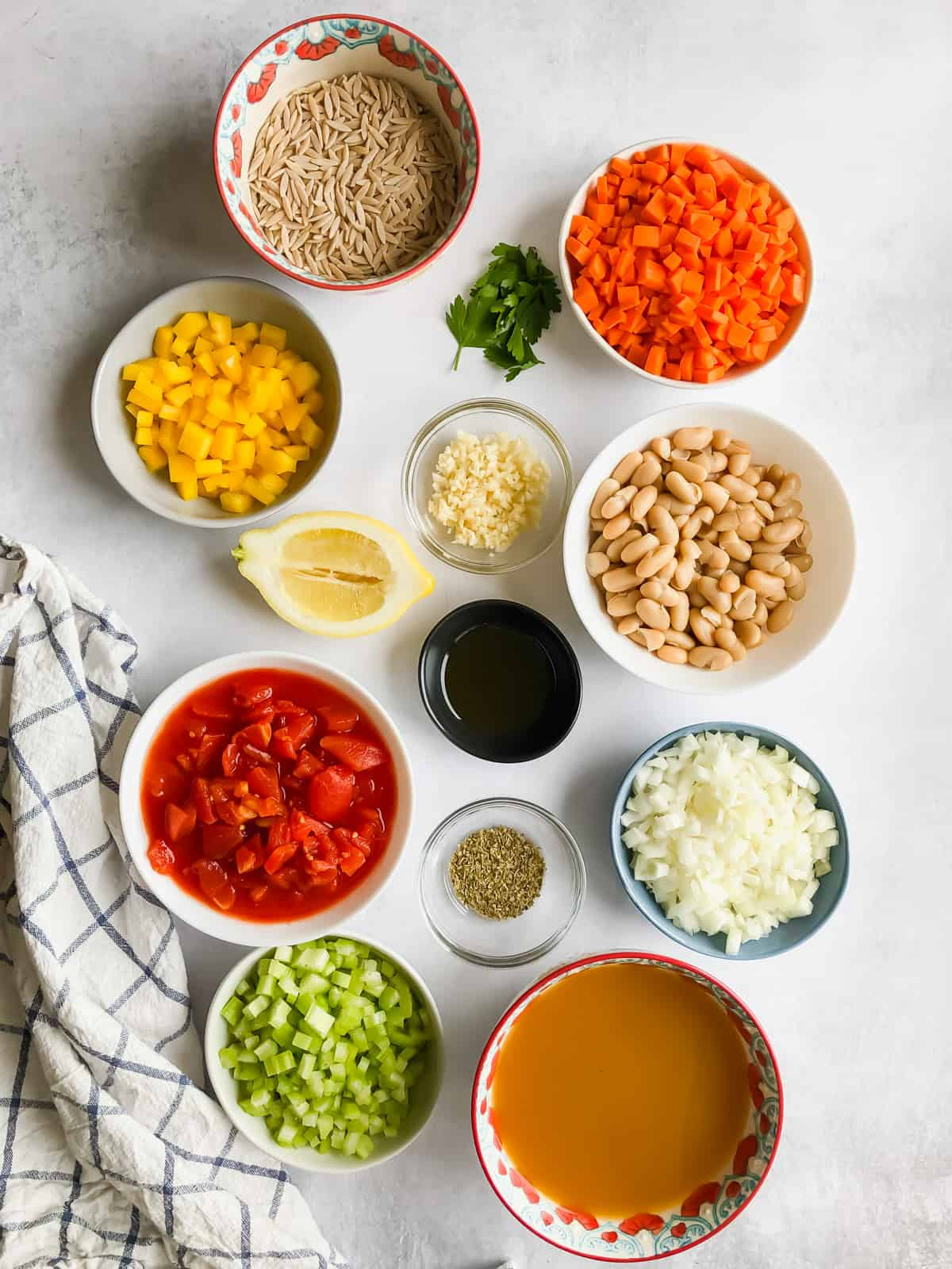 Ingredients for Vegetable Orzo Soup in bowls