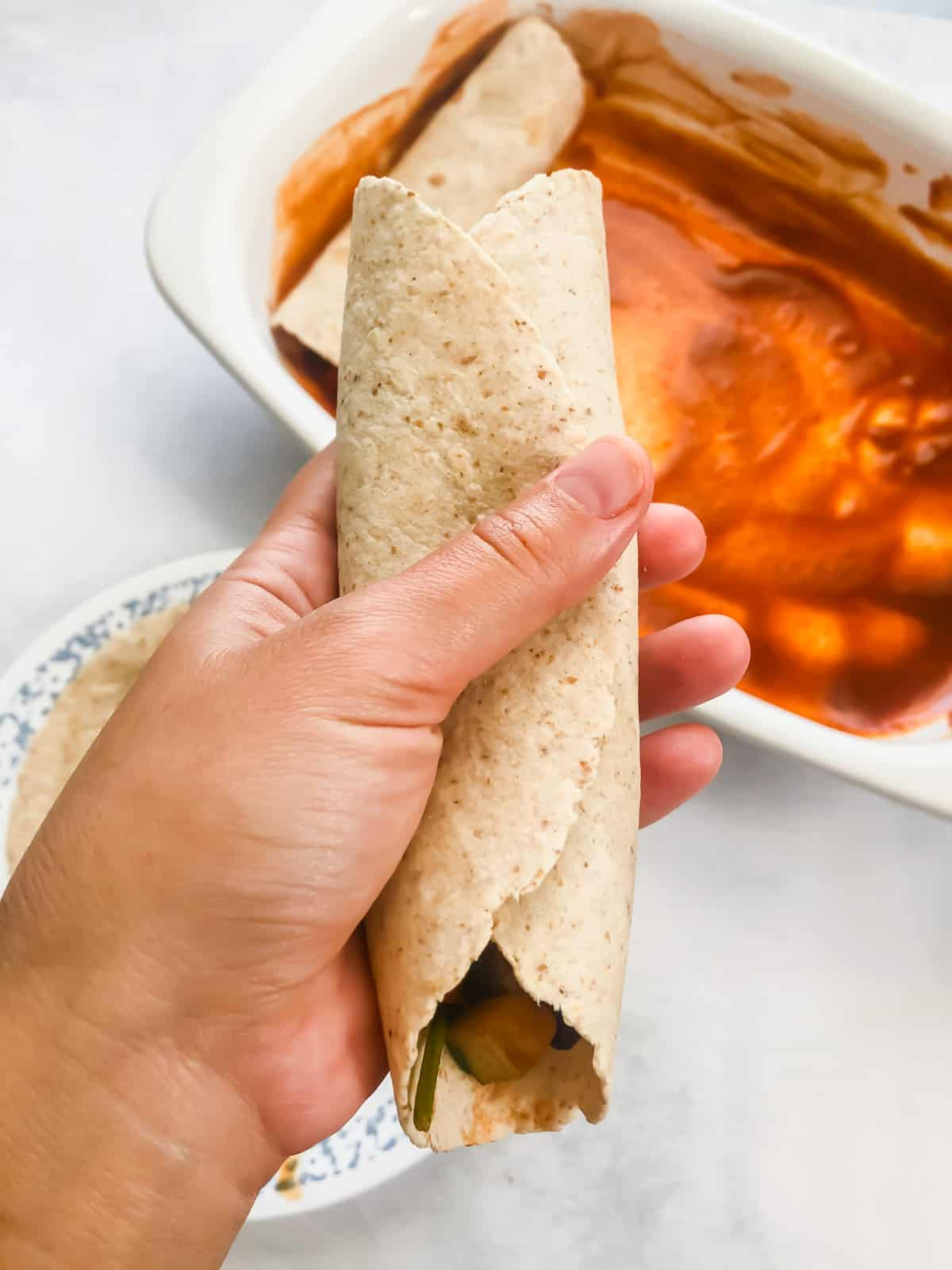 hand holding folded stuffed tortilla