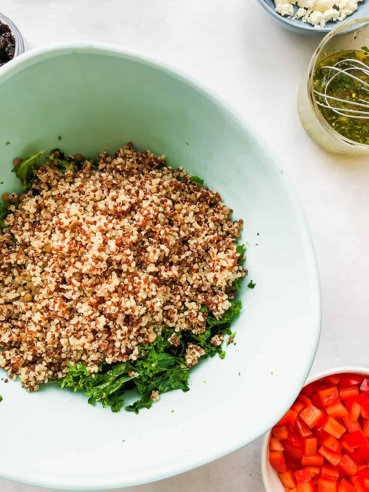 kale quinoa and lentils in blue bowl